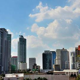 Skyline with hotels and skyscrapers of modern urban Bangkok Thailand by Imran Ahmed