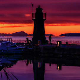 Sunset on the lighthouse Italy by Rita Di Lalla