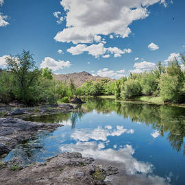 Tranquil River Scene by Jurgen Lorenzen