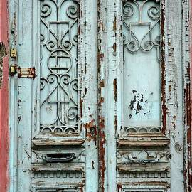 Weathered run down textured wood door and pink walls Tbilisi Georgia by Imran Ahmed