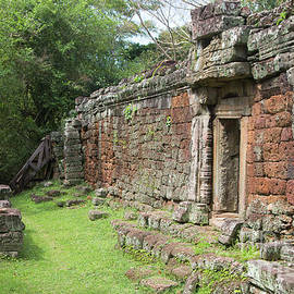 12th Century Temple Walls Cambodia  by Chuck Kuhn