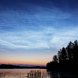 Night shining clouds over lake by Juhani Viitanen