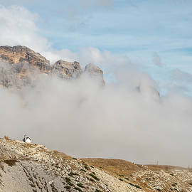 Mountain landscape with fog in autumn. Tre Cime dolomiti Italy. by Michalakis Ppalis