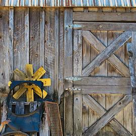A Barn Door and Fan by Chuck Burdick