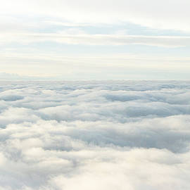 Above a Sea of clouds by Susan Hope Finley