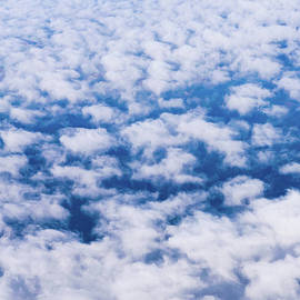 Abstract Pattern Above White Clouds and Blue Sky by Andreea Eva Herczegh