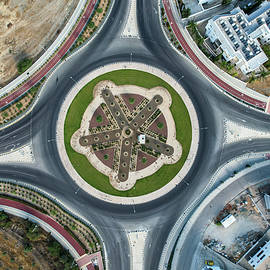 Aerial drone view of a modern designed roundabout by Michalakis Ppalis