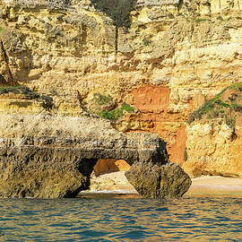 Algarve Gold Coast Sail - Bold Colored Seacliffs with a Natural Arch in Lagos Portugal by Georgia Mizuleva