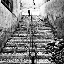 Alone at the Top in Lisbon Portugal by John Rizzuto