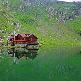 Alpine chalet at Balea lake by Tibor Tivadar Kui