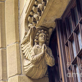 An Angel carving on The Church of the Holy Name of Jesus on Oxford Road, Manchester, England. by Pics By Tony