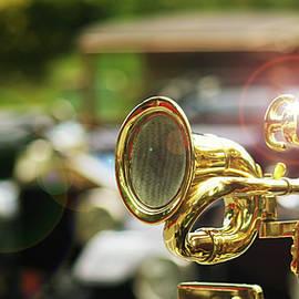An Antique Brass Car Horn on a Vintage Automobile by Derrick Neill