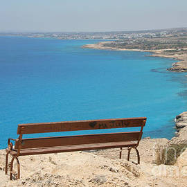 An Empty Bench over the Great Blue by Clay Cofer