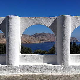 Arches view to Aegean blue. by Paul Boizot