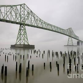 Astoria-Megler Bridge across Columbia River on Foggy Morning by Tom Schwabel