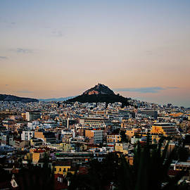 Athens Cityscape Evening with Orange Sky by Cassi Moghan