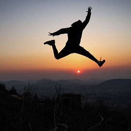 Athlete jump over sun by Vaclav Sonnek