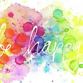 Be happy hand written with paint splatters by Karen Kaspar