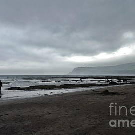 Beach with storm clouds, Robin Hoods Bay by Paul Boizot