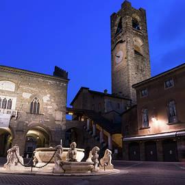 Beautiful Bergamo at Night - Piazza Vecchia Contarini Fountain and Campanone Clocktower by Georgia Mizuleva