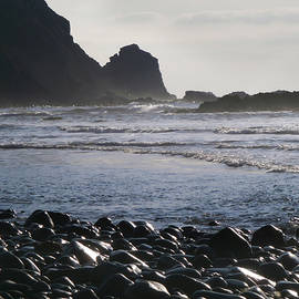 Beautiful Black Pebble Beach with Sparkling Sea Waves in Dreamy Twilight by Aneta Soukalova