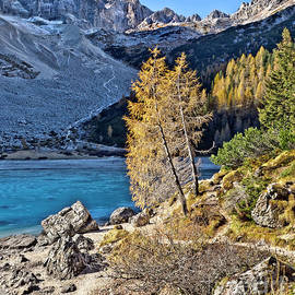 beautiful high altitude mountain lake Sorapiss covered with ice AUTUMN OCTOBERDolimites North Italy