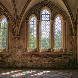 Beautiful arched windows of a medieval abbey in England  by Patricia Hofmeester