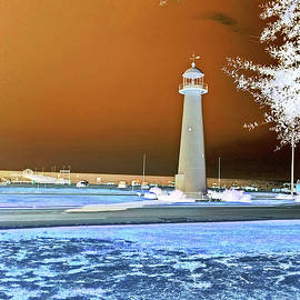 Biloxi Lighthouse On Highway 90 in Biloxi Mississippi on an Eerie Night by Marian Bell