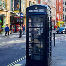Black telephone box, Covent Garden, London by Joe Vella