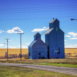 Blue classic grain elevators by Tatiana Travelways