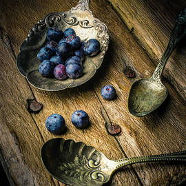 Blueberries In Antique Spoons by Garry Gay