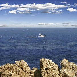 Boat going out to sea, Sa Pinta des Pon, Spain by Tony Hulme