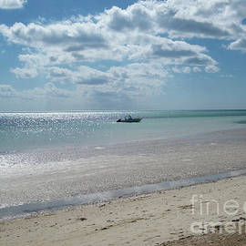 Boat on Bahama Beach by Mary Mikawoz