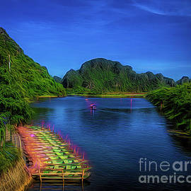 Boats waiting tourists Tam Coc Vietnam   by Chuck Kuhn
