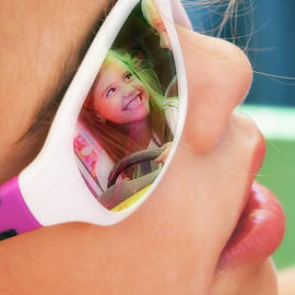 Bored Little Girl With Sunglasses Imagines Being At The Funfair  by Flavio Vieri