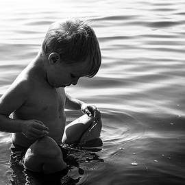 Boy in the calming water