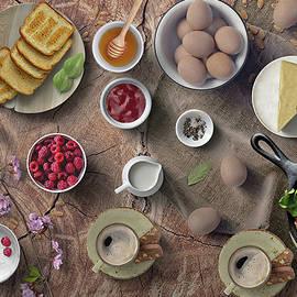 Breakfast With Toast Eggs Cheese Honey And Berries by Johanna Hurmerinta
