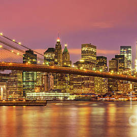 Brooklyn Bridge and Manhattan Skyline at night, New York, USA by Neale And Judith Clark