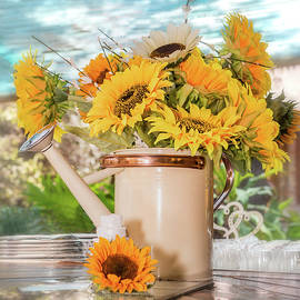 Bunch of Sunflowers in a tin watering by Ronel BRODERICK