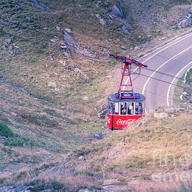 Cable car over mountain road by Claudia M Photography