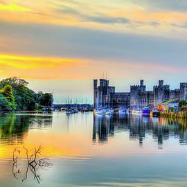 Caernarfon Castle Sunset On The Marina by Paul Thompson