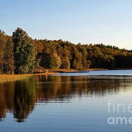 Calm forest lake in autumn by Birgitta Astrand