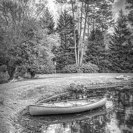 Canoe on the Edge of the Lake in Black and White by Debra and Dave Vanderlaan