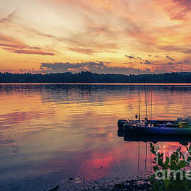 Canoes at sunset by Claudia M Photography