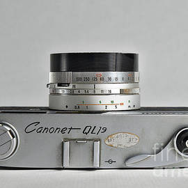 Canon analogue camera, model Canonet QL19. 35mm film camera, Top by Angelo DeVal
