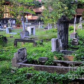 Catholic cemtery graveyard with graves and tombstones in Jaffna Sri Lanka by Imran Ahmed