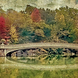 Central Park Bow Bridge in autumn foliage by Geraldine Scull