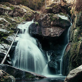 Cerny potok waterfall in Jizera mountains at sunset. A magical spectacle of the jewel of Czech nature. Clear water flows through the rock and creates beautiful shapes by Vaclav Sonnek