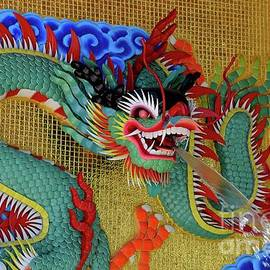 Chinese dragon mosaic sculpture fountain in temple courtyard Pattani Thailand by Imran Ahmed