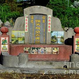 Chinese grave and ornate tombstone at cemetery graveyard Ipoh Malaysia by Imran Ahmed